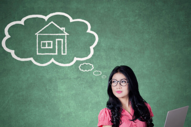 woman with thought bubble and house inside