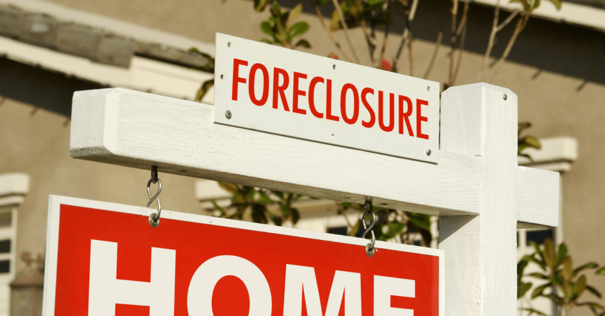 Red Foreclosure sign on a for sale sign